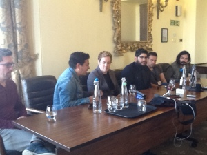 Salvador at their press conference. Nic Gonzales is second left (in the blue shirt); Craig is on the left. Alejandro is at the other end; on the right.